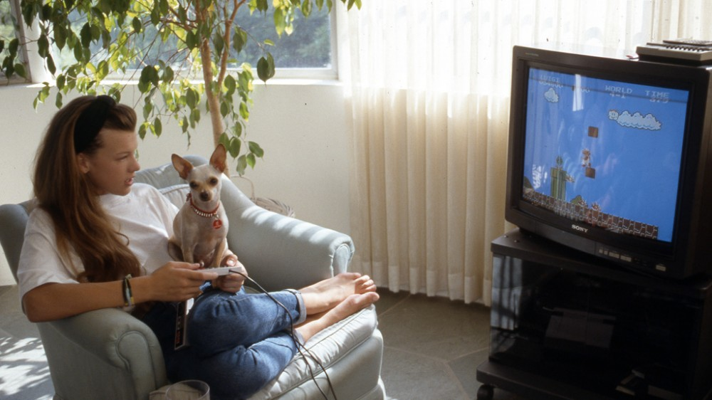 """Milla Jovovich Playing Super Mario on Her Nintendo with her dog """"Doc"""" by Peter Duke ©2013 All rights reserved"""