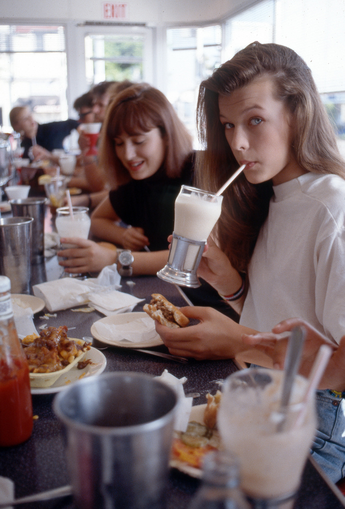 Milla Jovovich eating a Cheeseburger, Chocolate Malt and Chili Cheese Burger by Peter Duke ©2013 All Rights Reserved